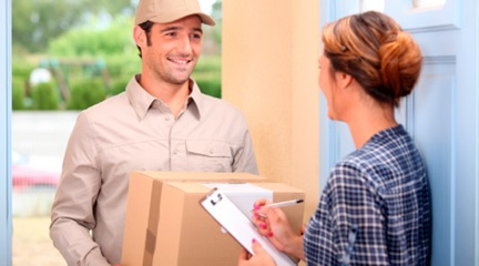 Delivery worker delivering a package to a woman at home