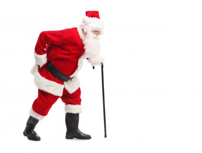 Santa with back pain walking with cane