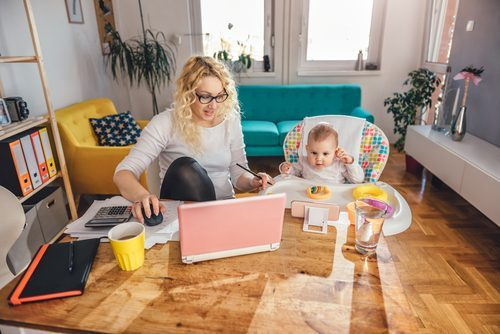 Woman working from home with daughter